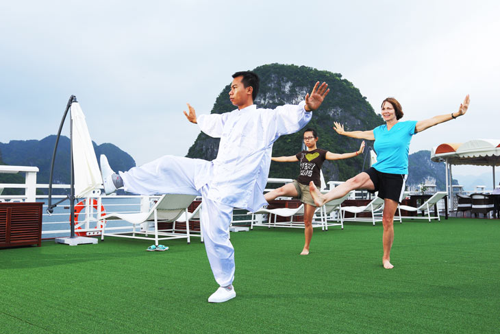 Welcome a new day on the bay with tai chi exercise on the sundeck