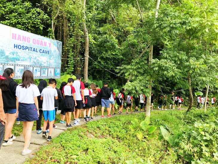 Explore Quan Y cave in Lan Ha Bay on Calypso cruise tour 2D1N